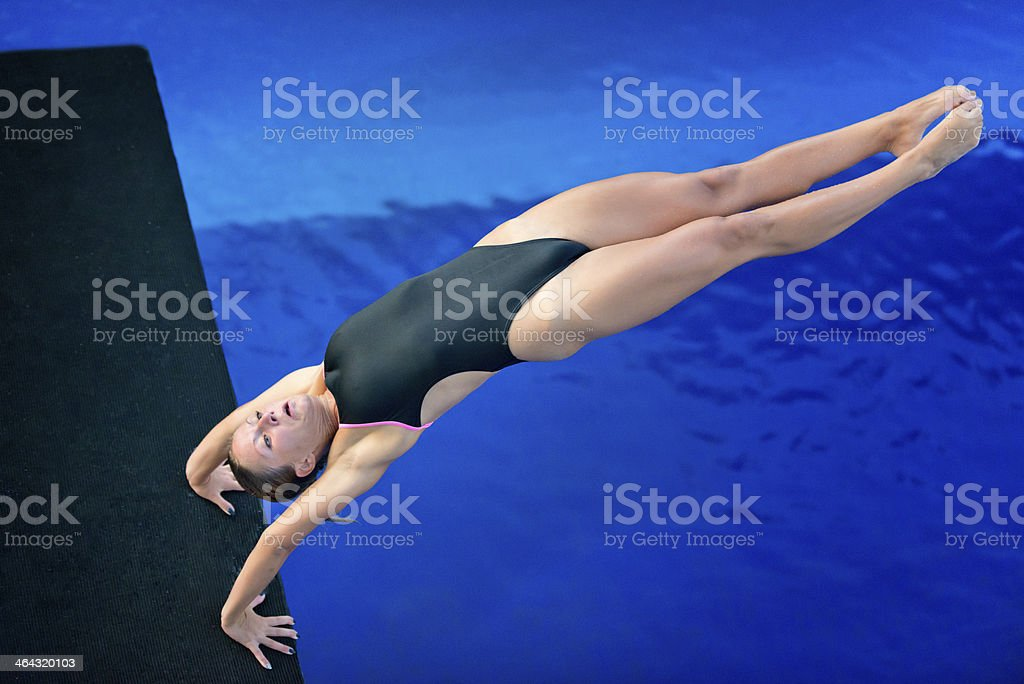 Armstand back dive stock photo