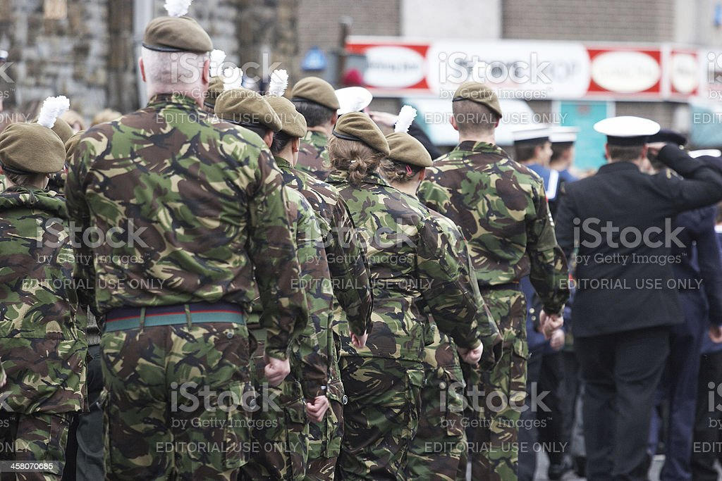 Army and navy cadets marching at remembrance day parade stock photo