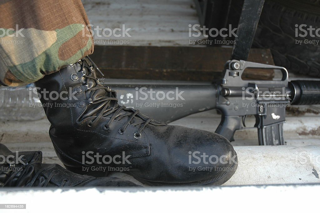 Army Boots And Rifles royalty-free stock photo