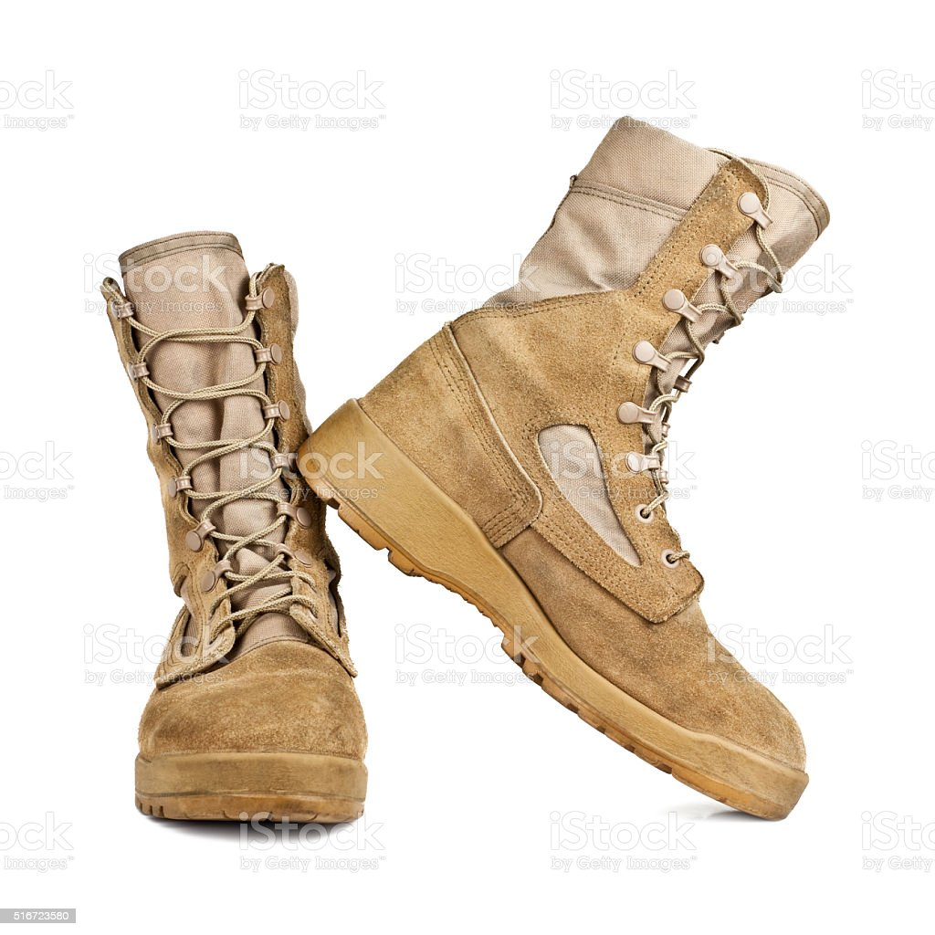 army boots in the desert coloring isolated on white background stock photo