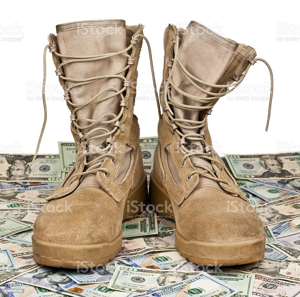 army boots on background of money stock photo