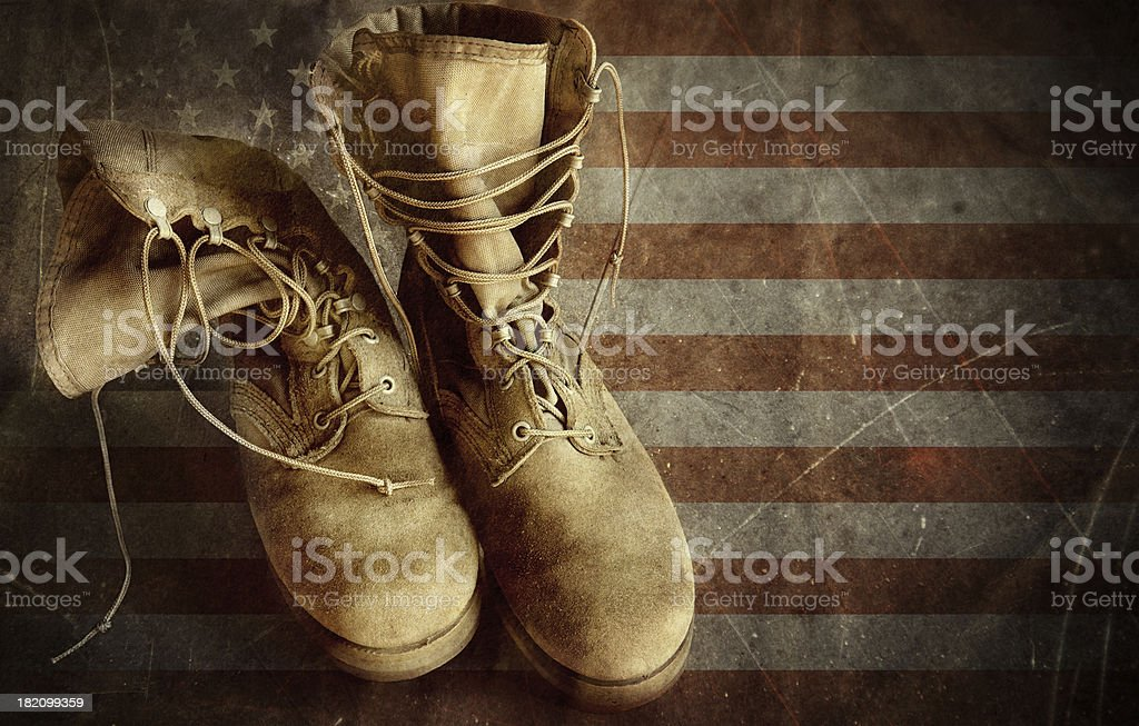 US Army boots on the old paper flag background stock photo