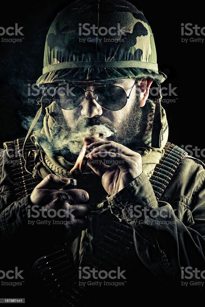 army captain lighting a cigar stock photo