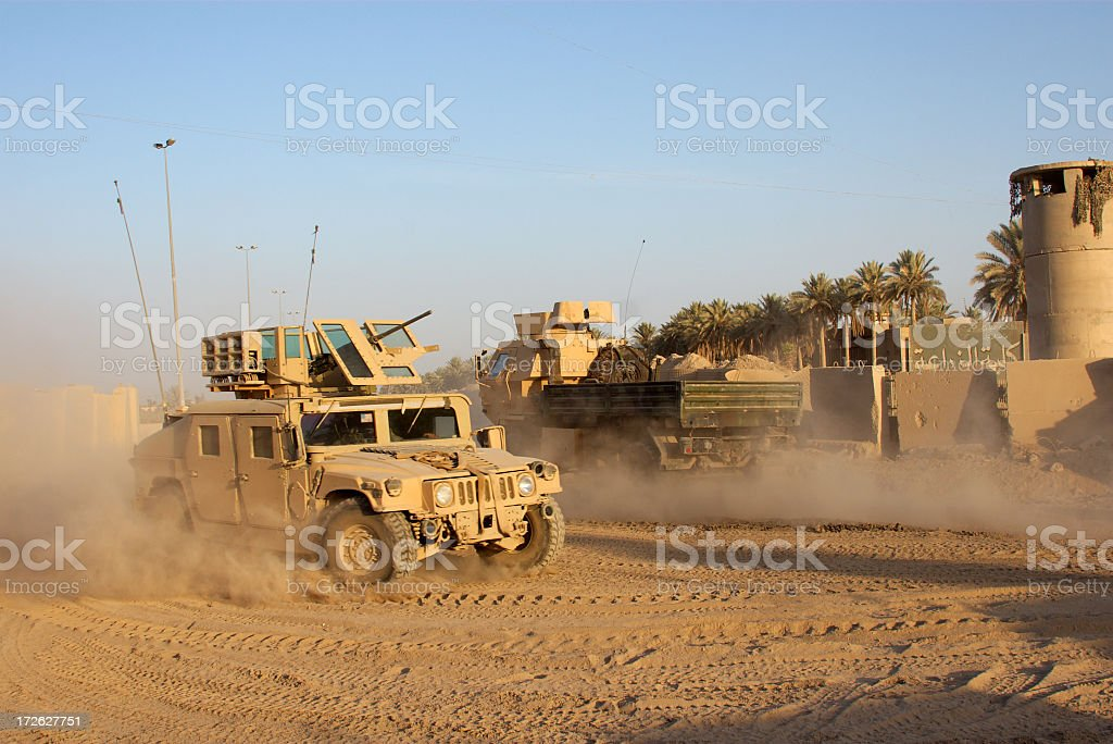 Army car going to its base on a dirty road stock photo
