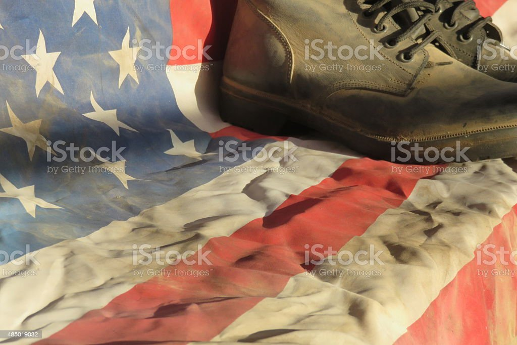 Army combat boots with American flag stock photo