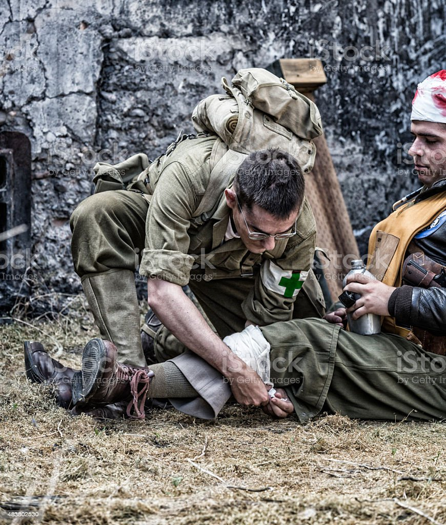 WWII US Army Combat Medic Treating Wounded USAAC Officer stock photo