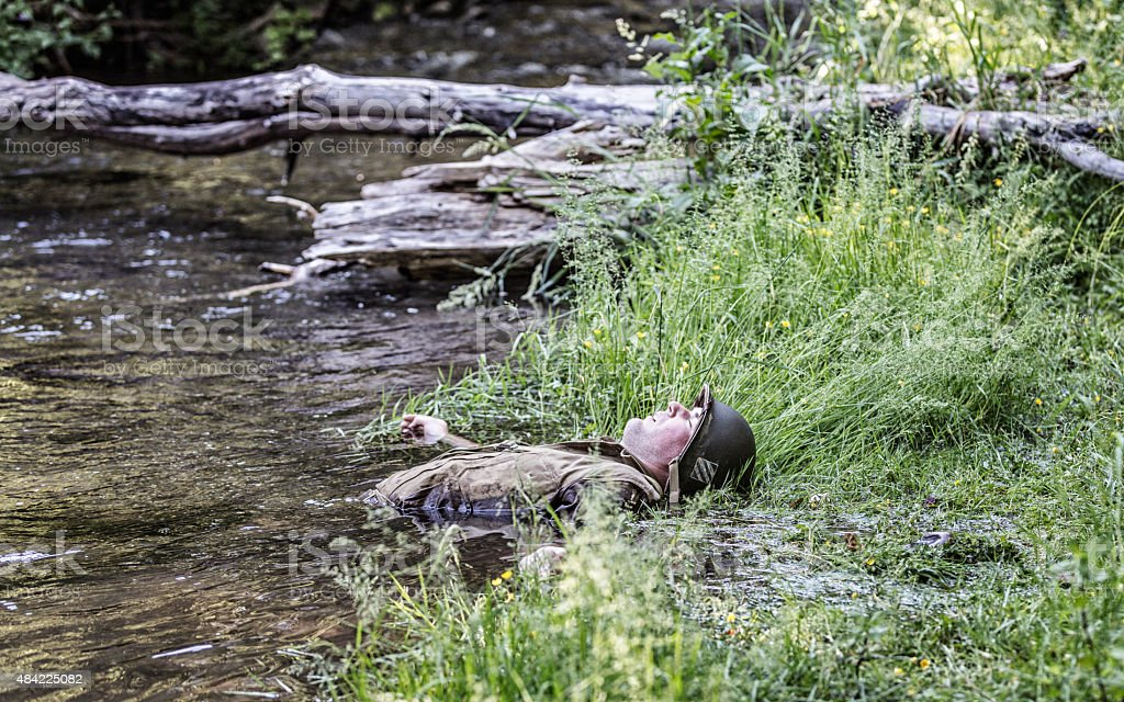 WWII US Army Combat Soldier Casualty Lying in Water stock photo