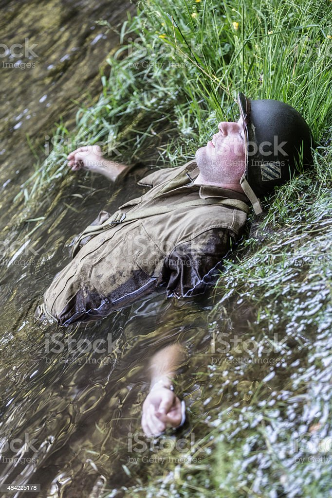 WWII US Army Combat Soldier Lying in Water stock photo