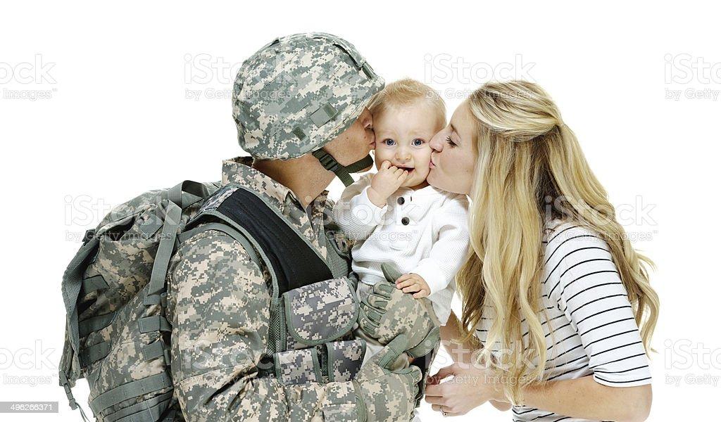 Army couple bonding their baby stock photo