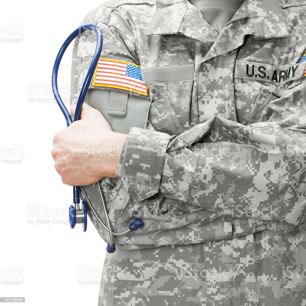 US Army doctor holding stethoscope - studio shot stock photo