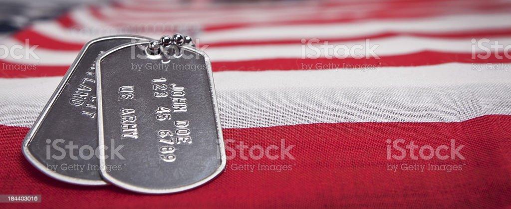 US Army Dog Tags on Flag stock photo