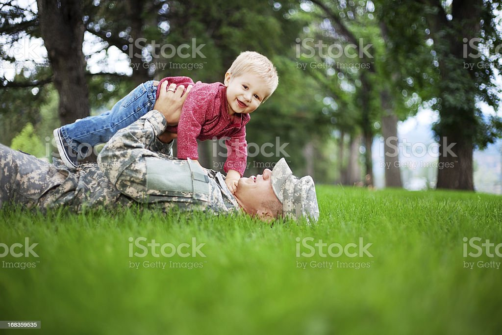 Army Family Series: Real American Soldier With Son stock photo