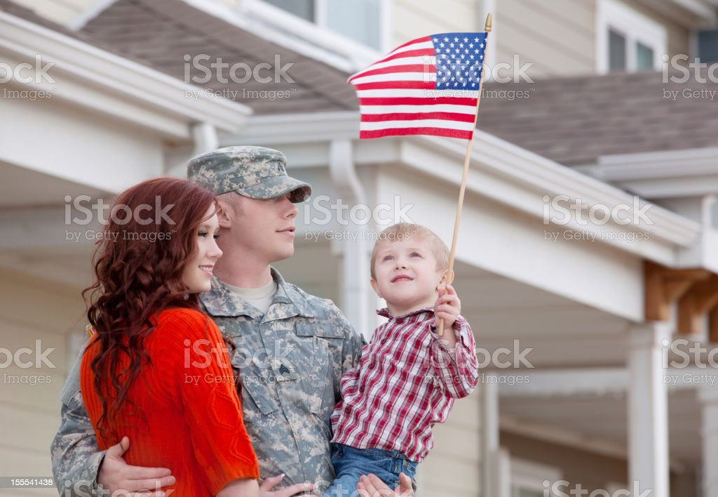 Army Family Series: Real American Soldier with Wife & Son Outdoor stock photo