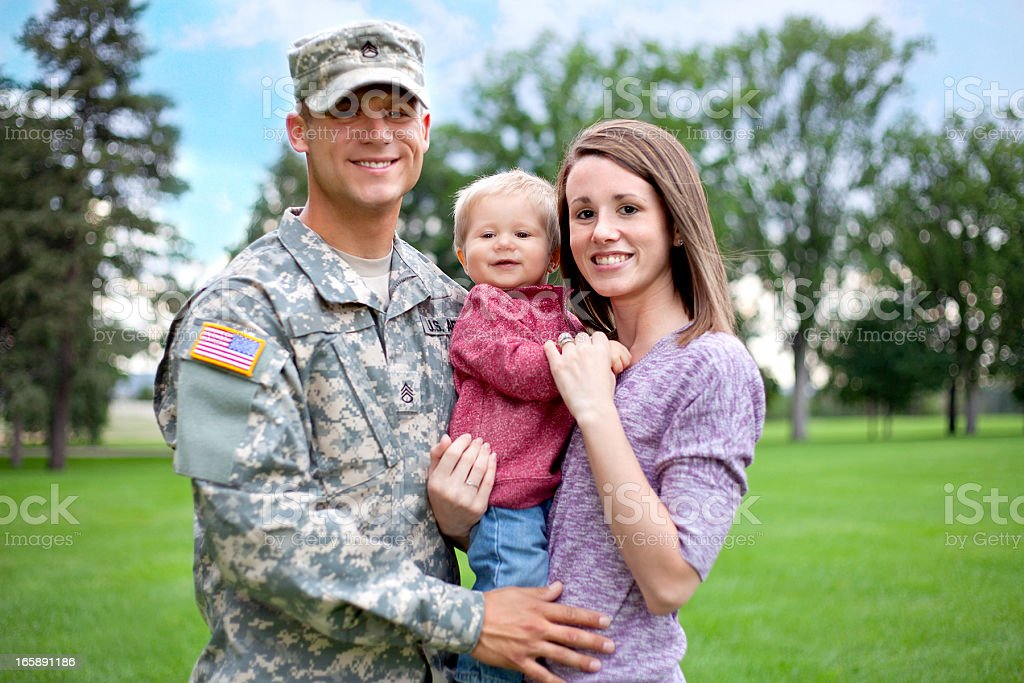 Army Family Series: Real American Soldier With Wife & Son royalty-free stock photo