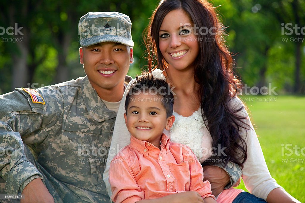 Army Family Series: Young American Soldier With Wife & Son royalty-free stock photo