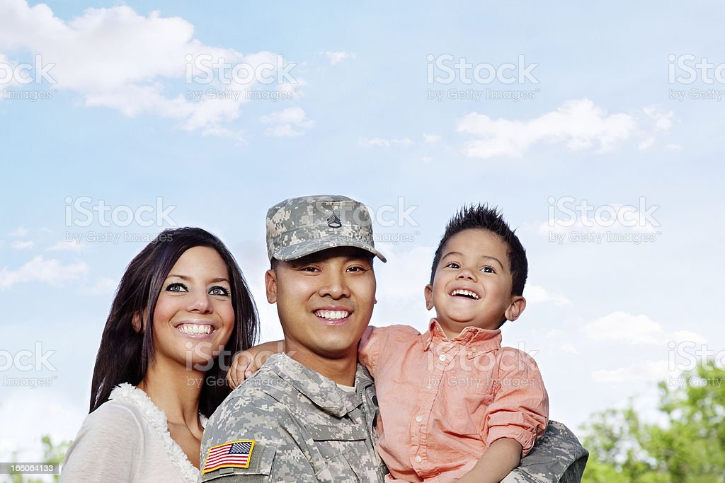 Army Family Series: Young US Soldier with Wife & Son royalty-free stock photo