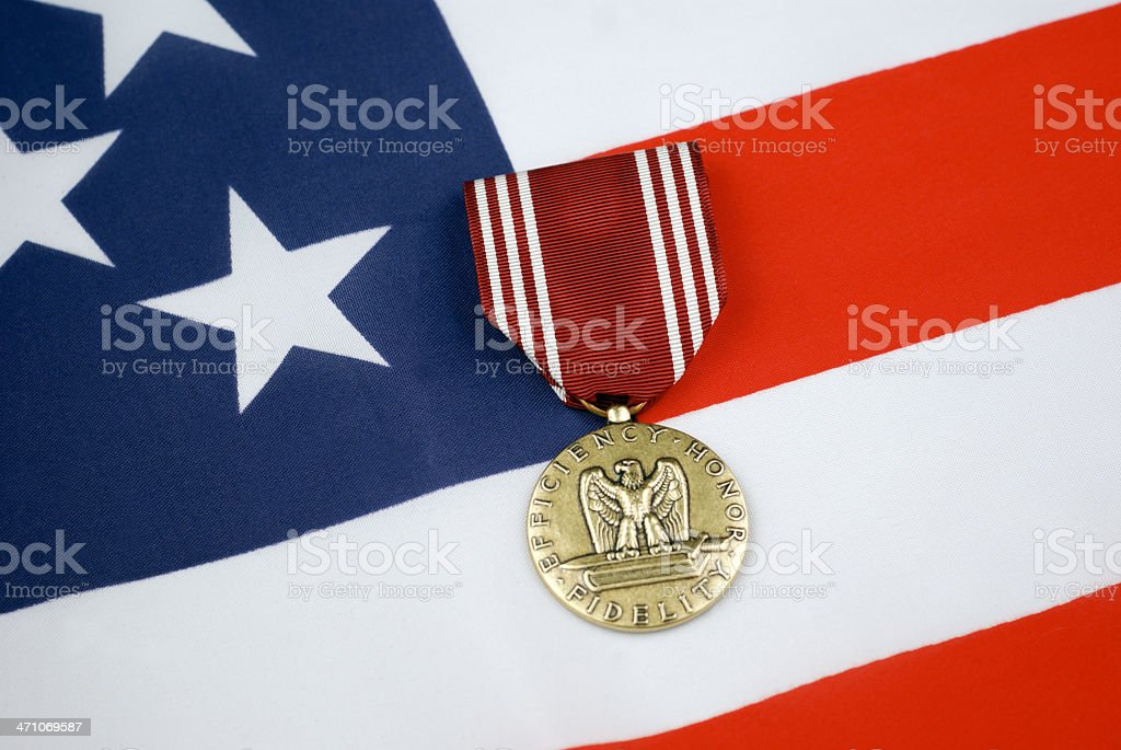 Army Good Conduct Medal with American Flag stock photo