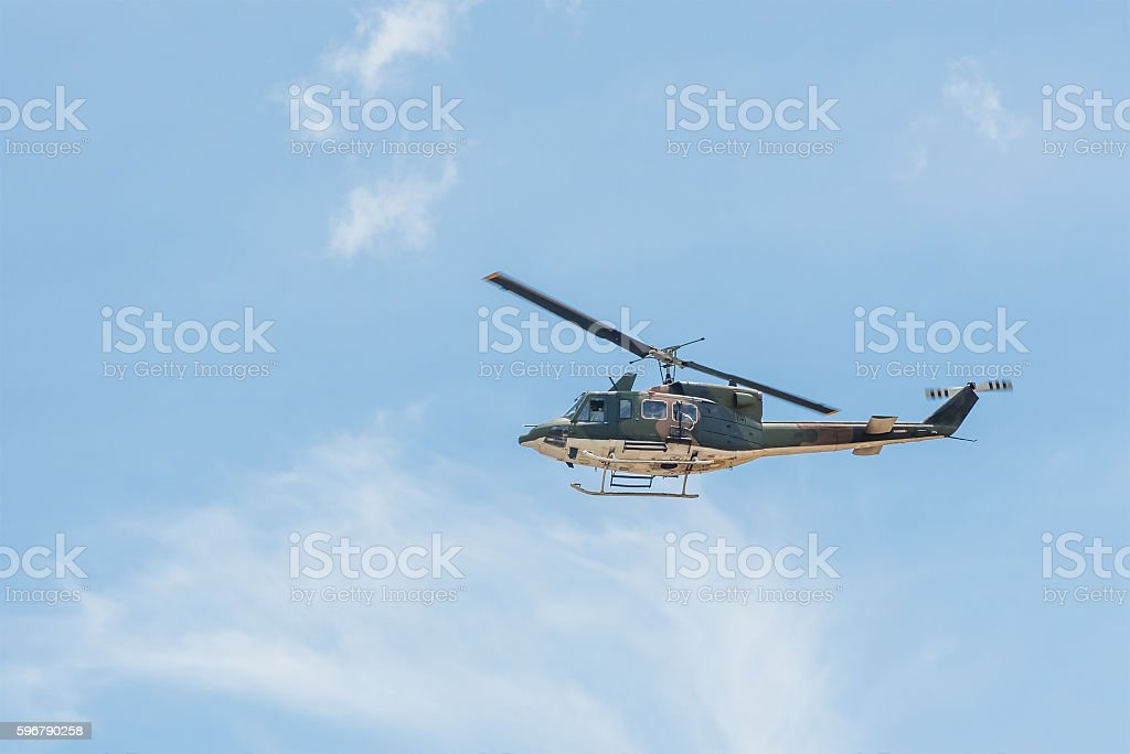 Army helicopter on blue sky. stock photo