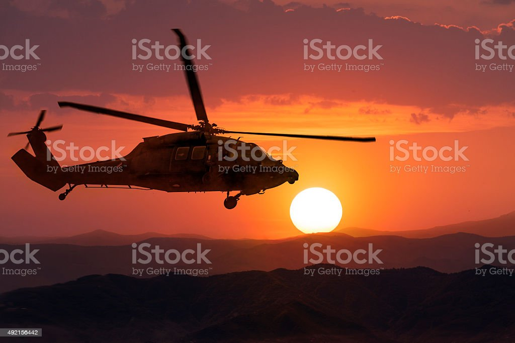 Army Helicopter on sunset background stock photo