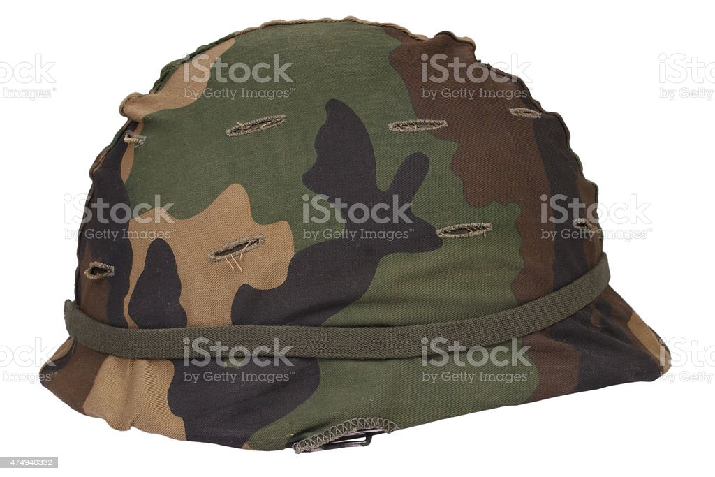 US Army helmet with woodland pattern camouflage cover stock photo