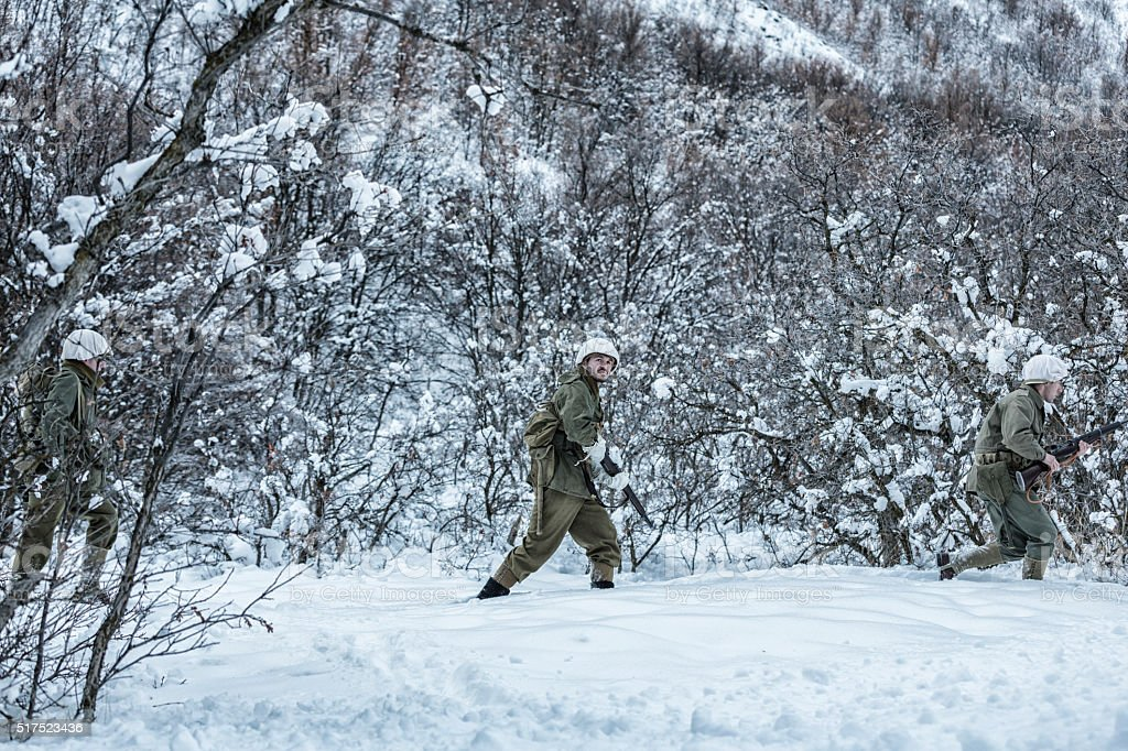 WWII US Army Infantry Combat Soldiers Platoon Winter Search Patrol stock photo