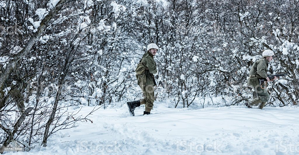 WWII US Army Infantry Combat Soldiers Platoon Winter Stealth Patrol stock photo