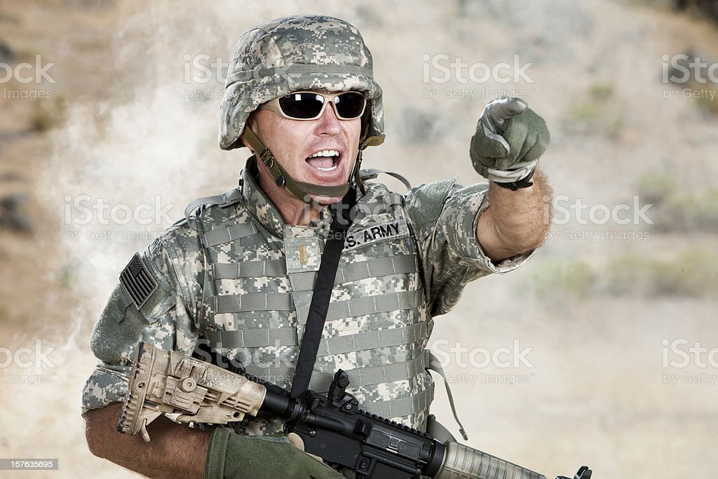 Army Lieutenant Yelling Orders on Battlefield stock photo