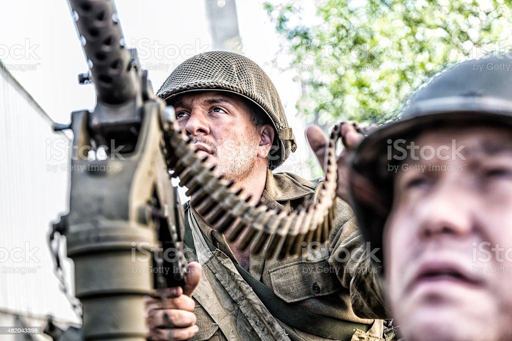 WWII US Army M1919 Browning .30 Caliber Machine Gunner stock photo