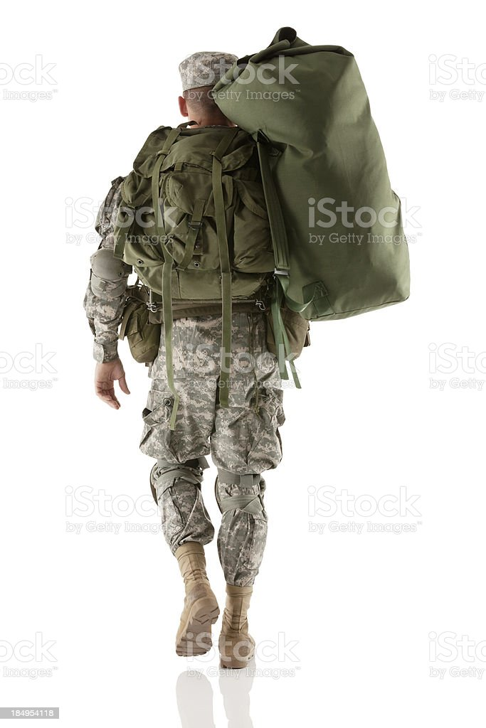 Army man carrying a luggage royalty-free stock photo