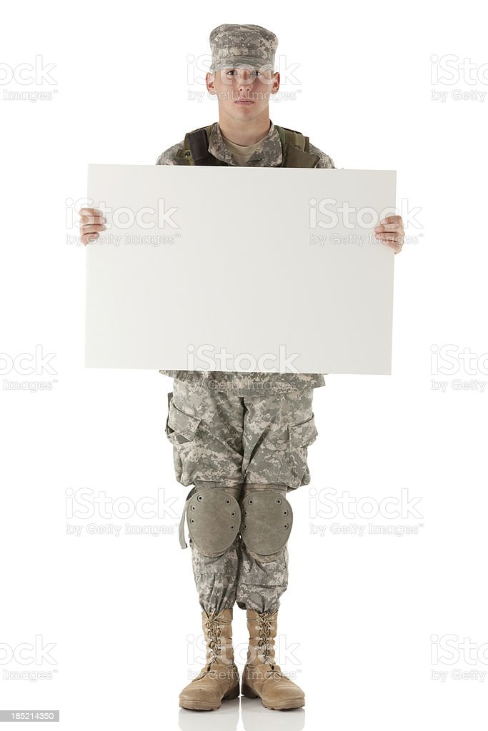 Army man holding a placard royalty-free stock photo