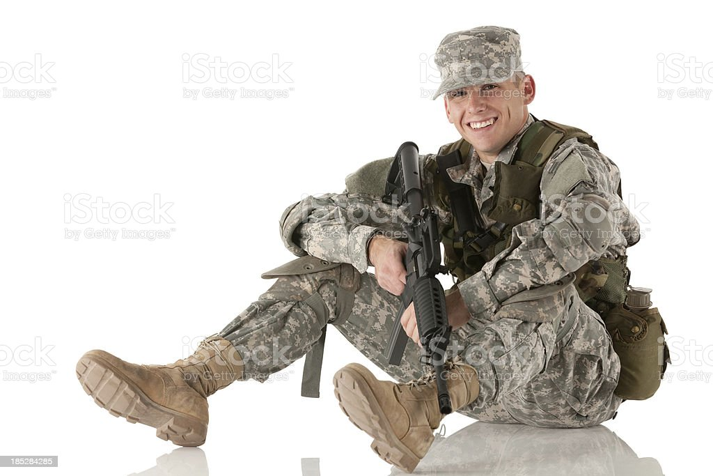 Army man sitting on the floor with a rifle royalty-free stock photo