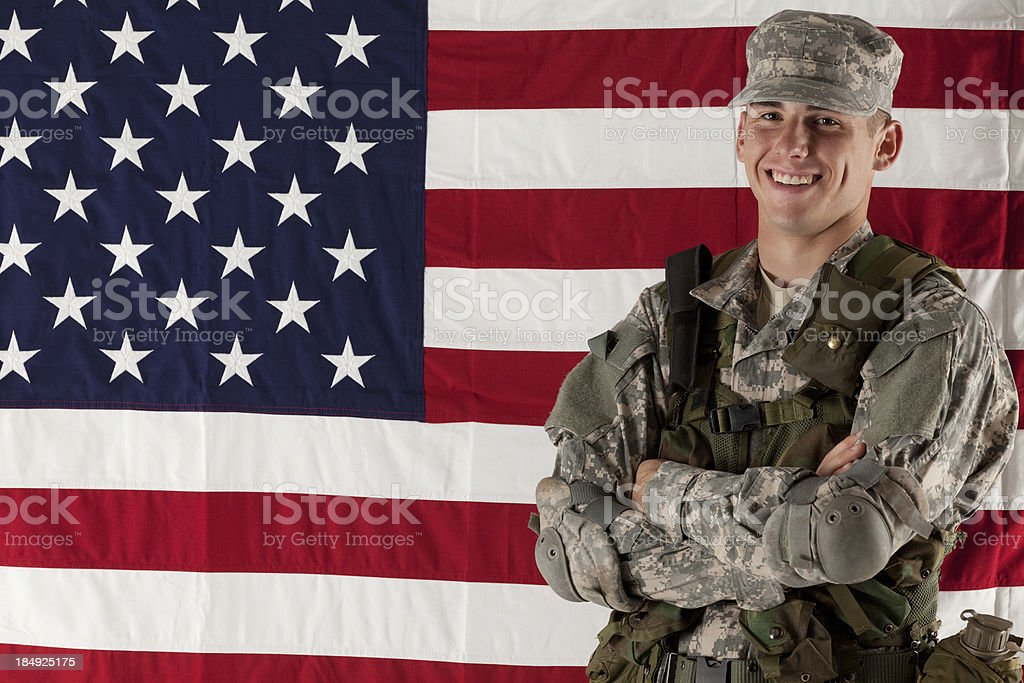 Army man standing in front of American flag royalty-free stock photo