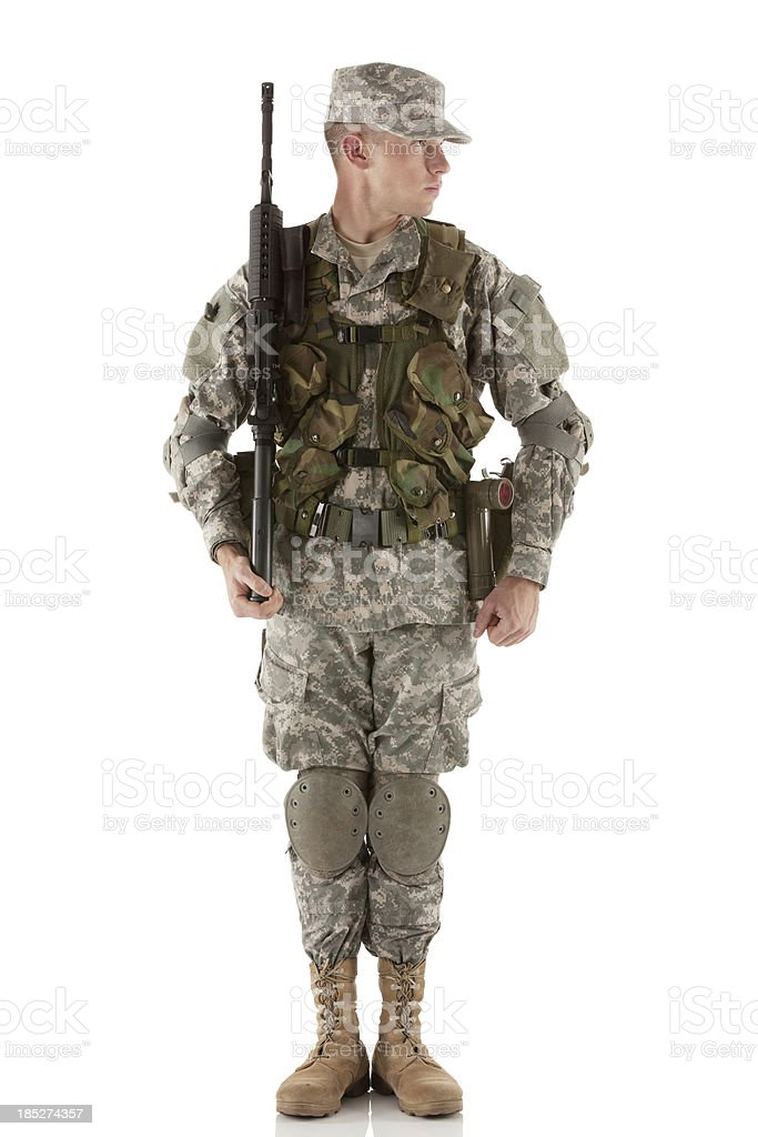 Army man standing with a rifle royalty-free stock photo