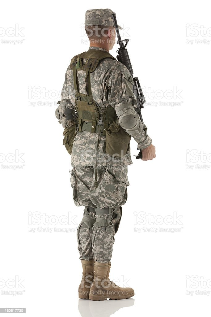 Army man standing with rifle royalty-free stock photo