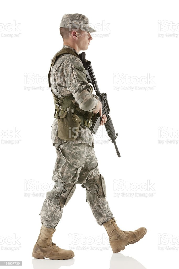 Army man walking with a rifle royalty-free stock photo