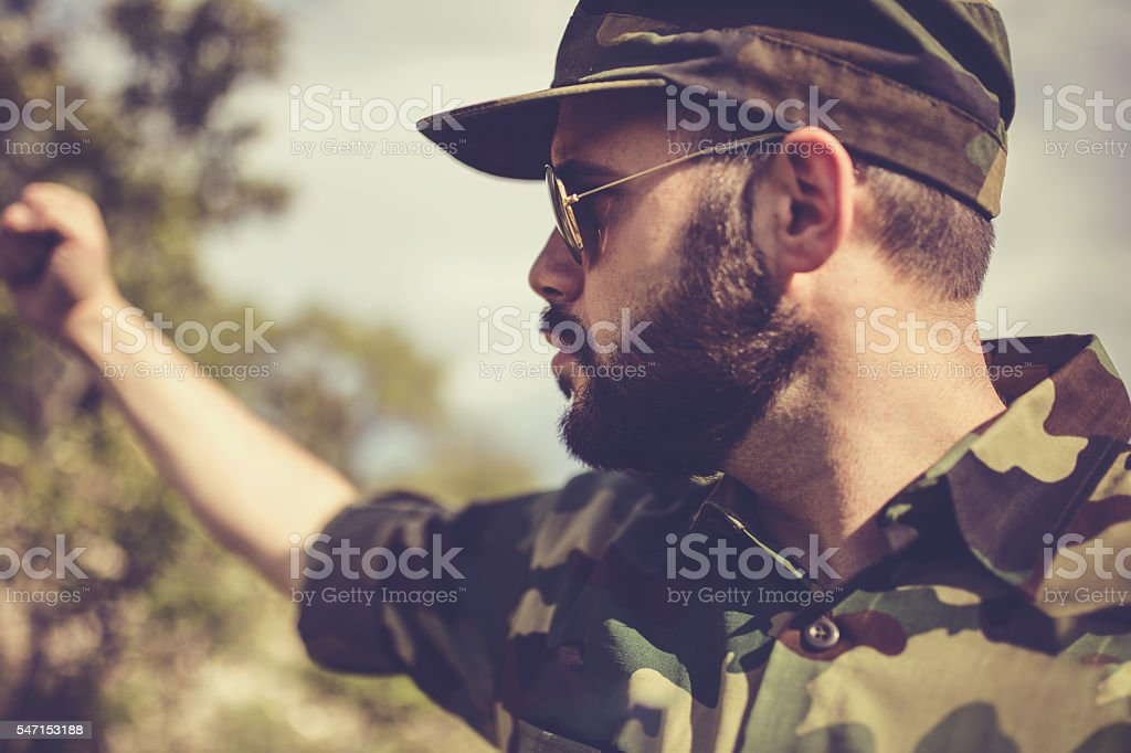 Army man with raised fist stock photo
