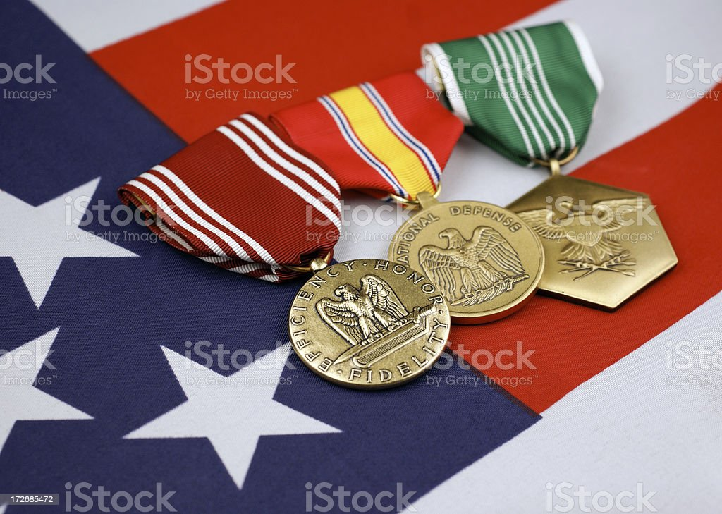 U.S. Army Medals with American Flag Background royalty-free stock photo