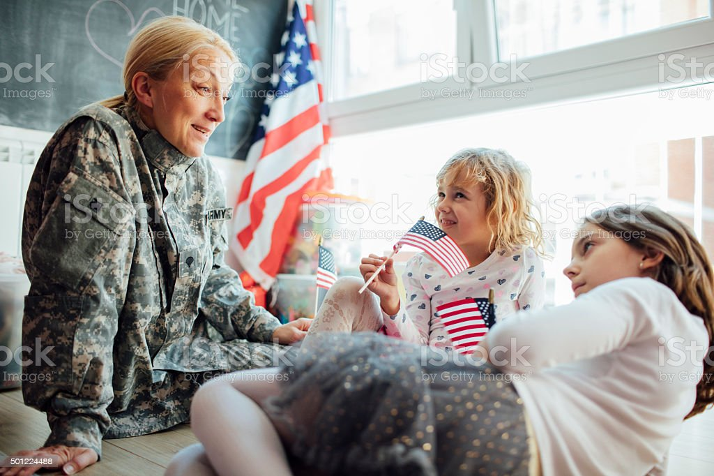Army Mom Reunites With Her Kids. stock photo