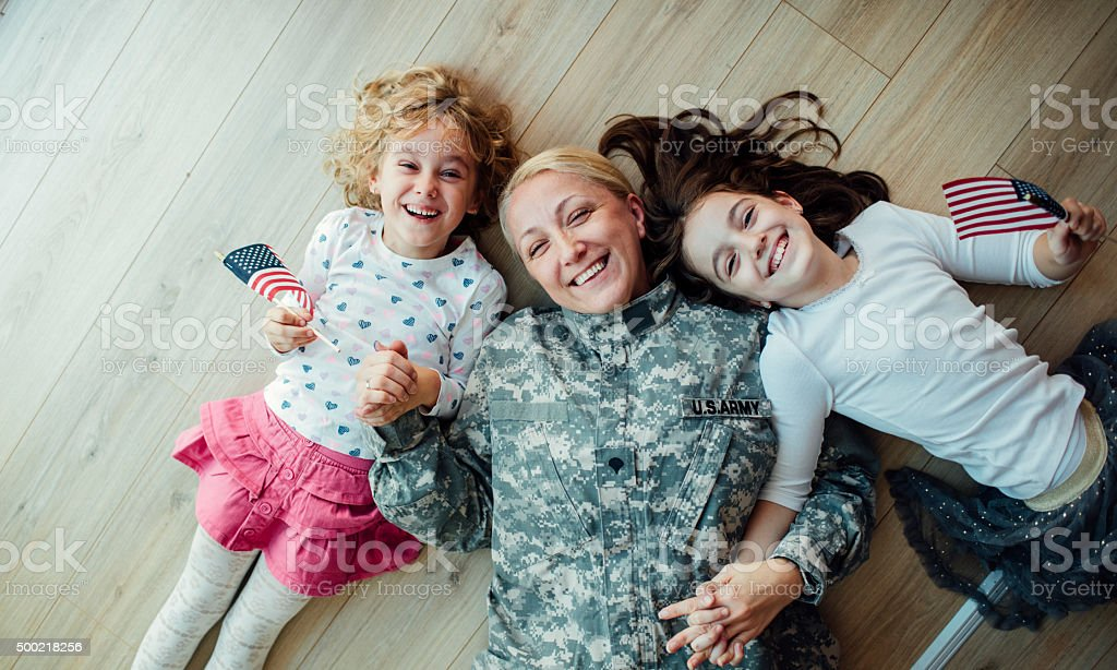 Army Mom Reunites With Her Little Girls. stock photo