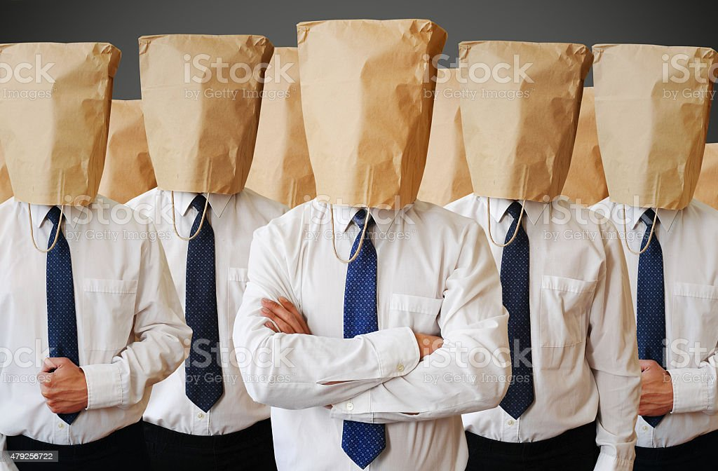 army of businessman with a paper bag on head stock photo