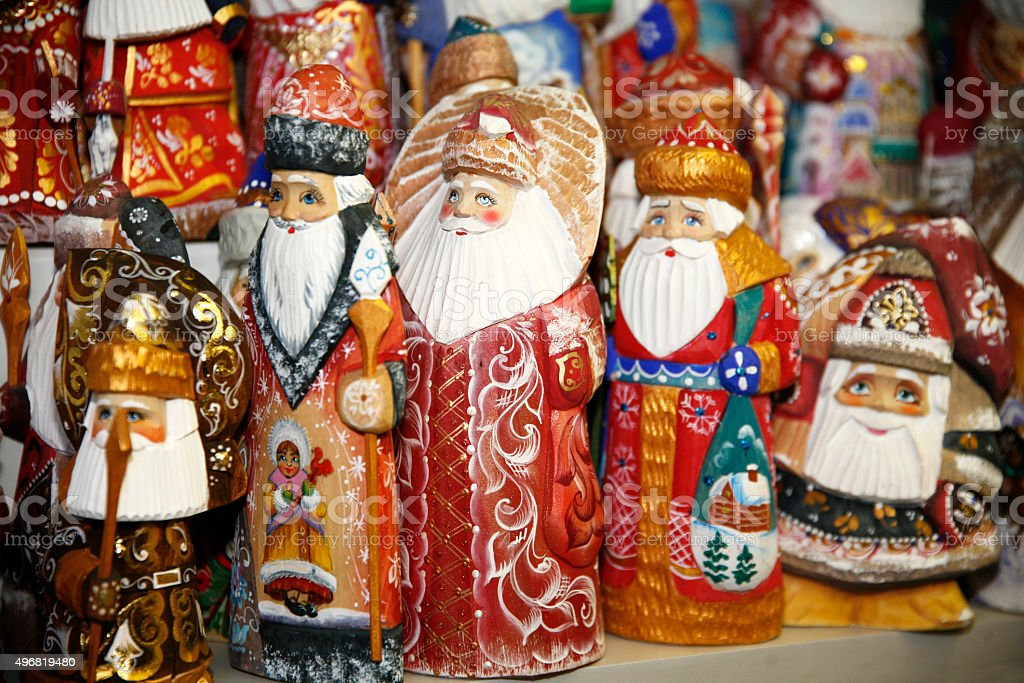 Army of kindly wooden santa claus puppets stock photo