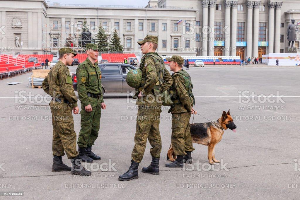 Army patrol with dog on Kuibyshev Square in Samara stock photo