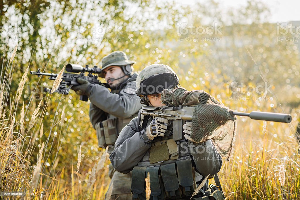 Army Rangers patroling on a battlefield stock photo
