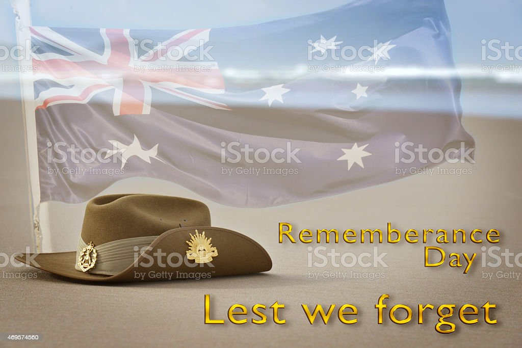 Army slouch hat on beach for Rememberance Day stock photo