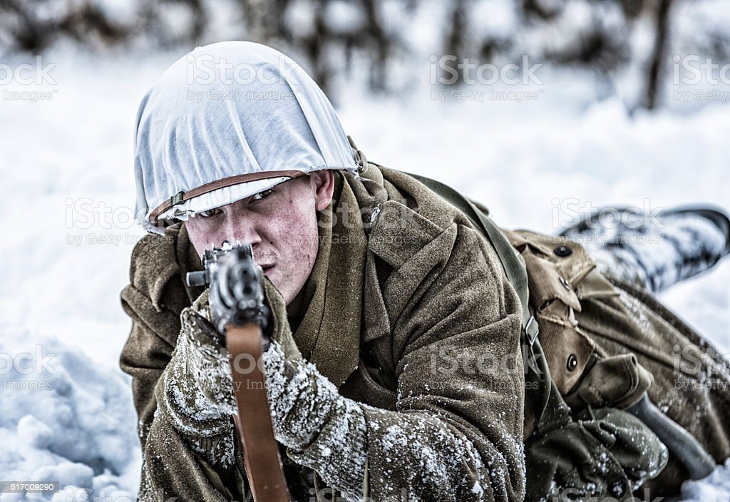 WWII US Army Sniper Soldier Aiming M1 Rifle in Winter stock photo