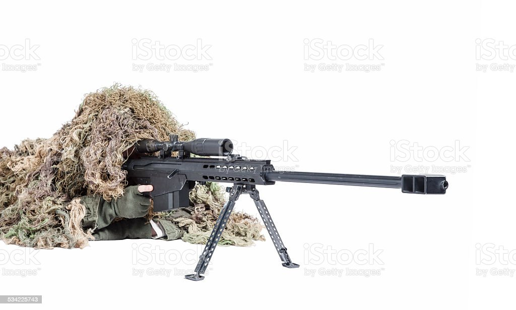 Army sniper wearing a ghillie suit stock photo