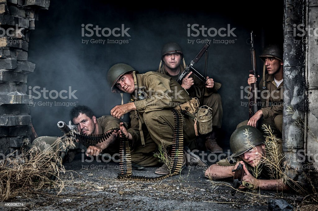 WWII Army Solders Defending a Battle Scarred Building stock photo