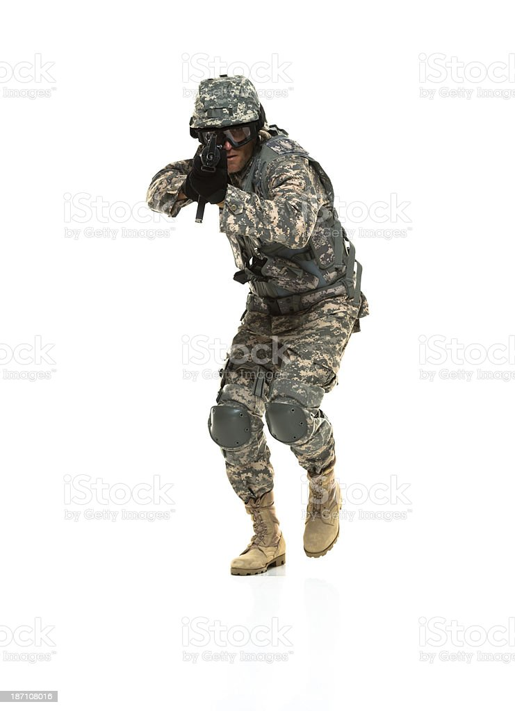 Army soldier aiming with a rifle royalty-free stock photo