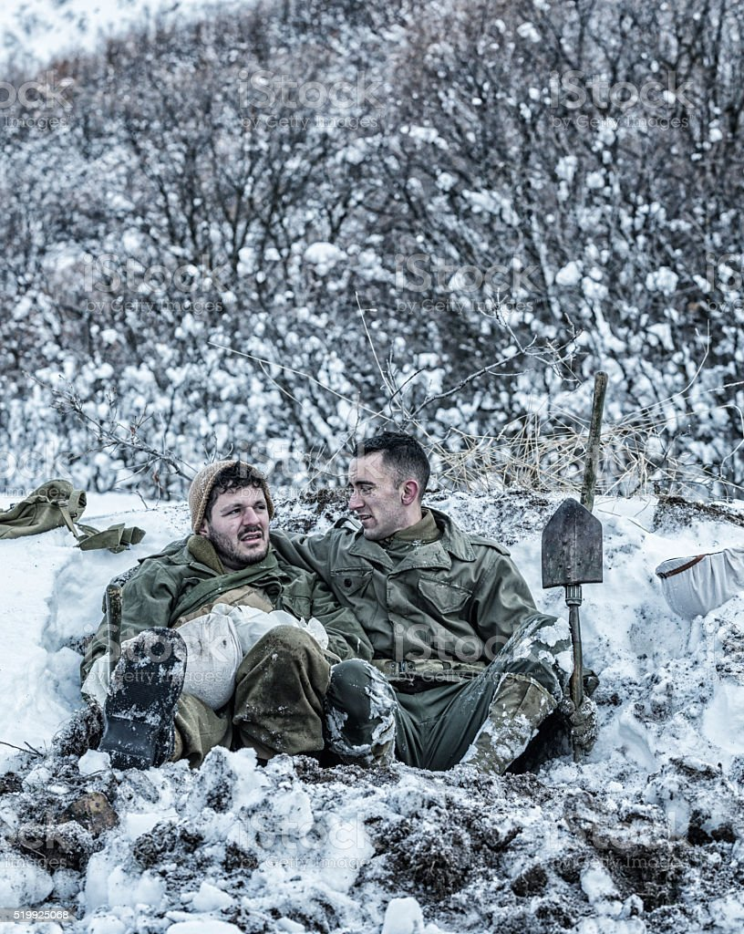 WWII US Army Soldier Buddies Serious Advice Conversation In Foxhole stock photo