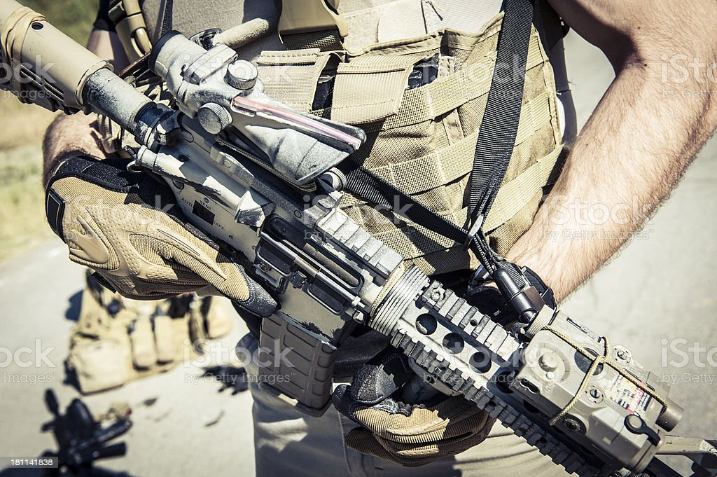 Army Soldier Carrying a Desert Painted M4 Assault Rifle stock photo